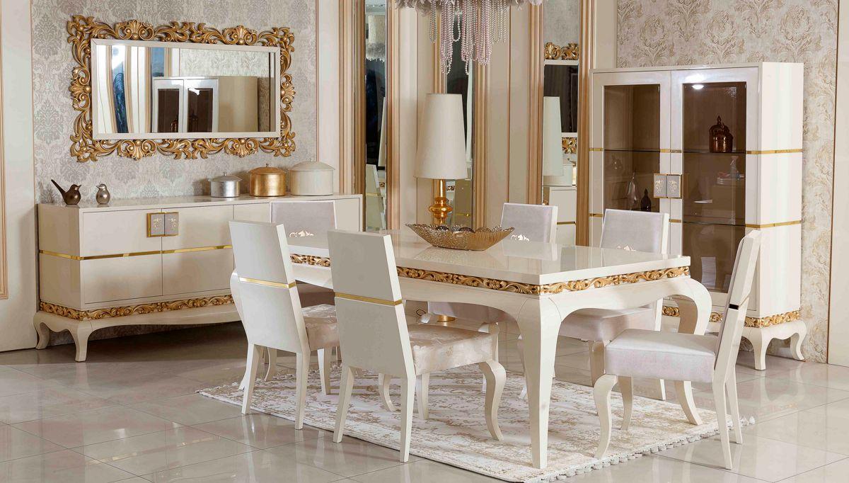 غرفة معيشة راقية باللون الأبيض و الذهبي