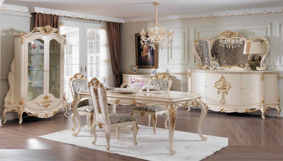 غرف معيشة كلاسيكية باللون الأبيض و الذهبي